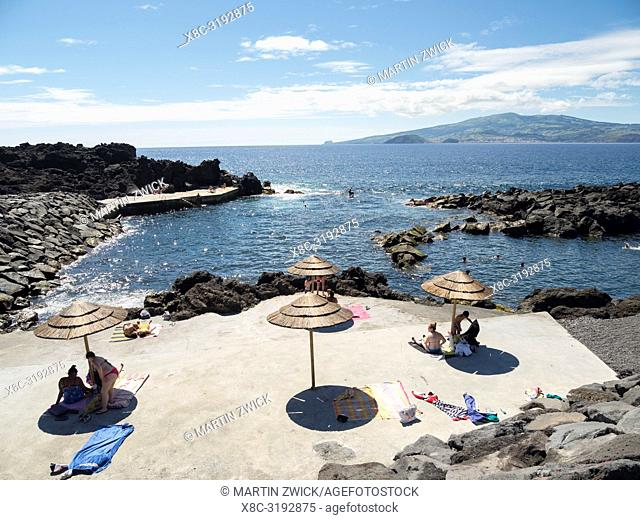 Beach in lava flow near Criacao Velha, Faial island in the background. Pico Island, an island in the Azores (Ilhas dos Acores) in the Atlantic ocean