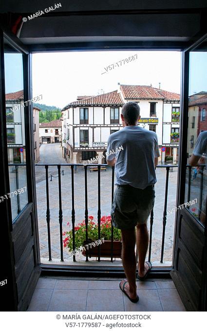 Man on the balcony. Covarrubias, Burgos province, Castilla Leon, Spain