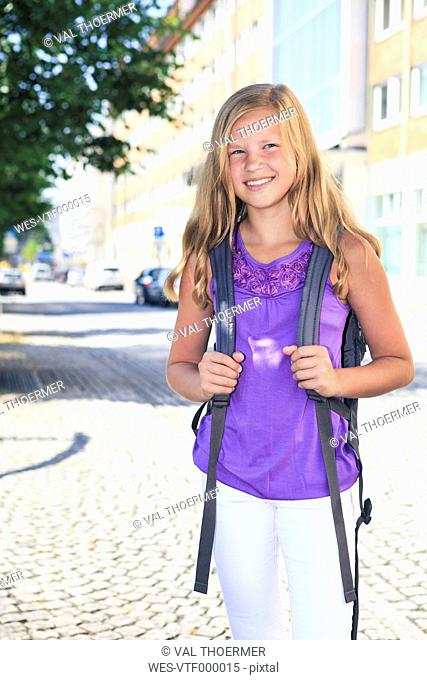 Germany, Portrait of teenage girl holding bag