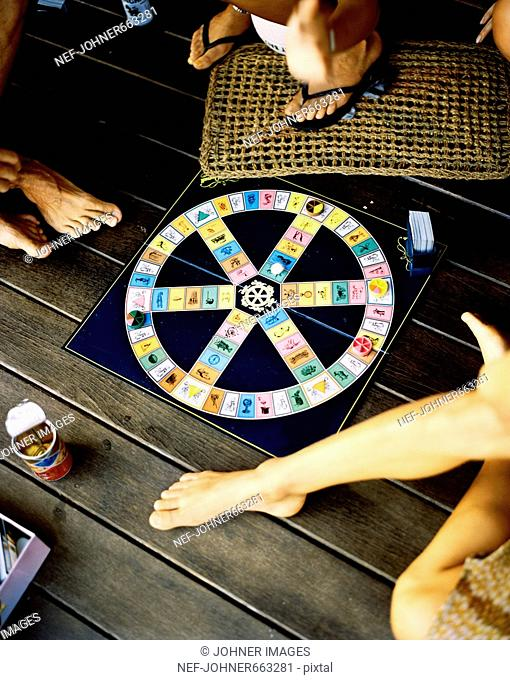 Friends playing Trivial Pursuit