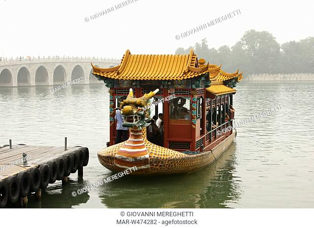 boat on the kunming lake and the The Seventeen-Arch Bridge, Summer Palace in Beijing. China
