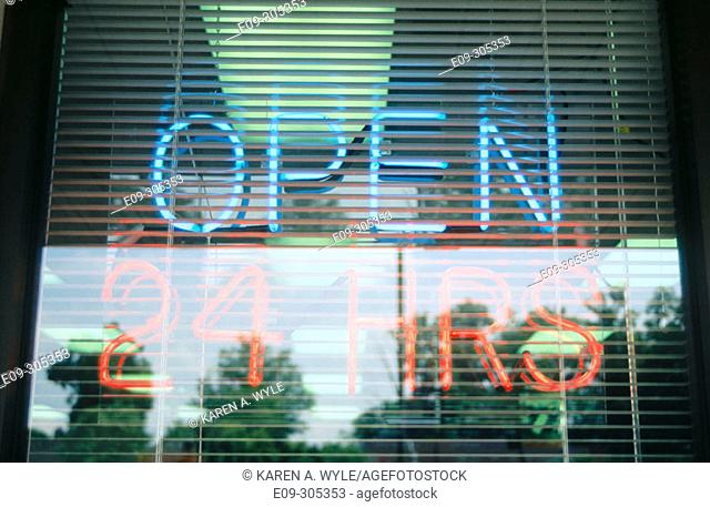 neon 'Open 24 Hrs' sign in window, blue and orange, Indiana, USA