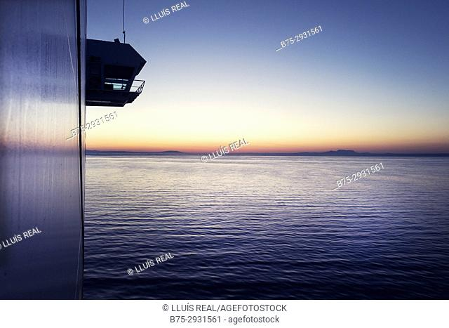 Sunrise seen from the deck of a ferry boat. Mediterranean Coast, Palma, Majorca, Balearic Islands, Spain