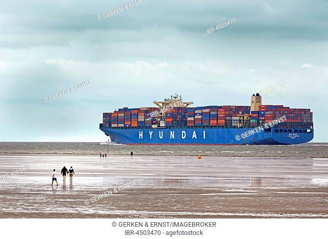Container ship in channel, Wadden Sea, Cuxhaven, Lower Saxony, Germany