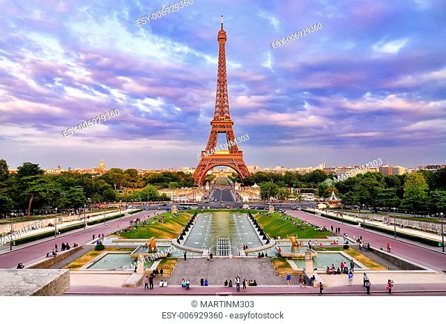 Eiffel tower at cloudy colorful sunset, Paris
