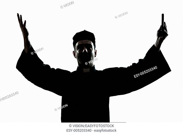one caucasian man priest silhouette blessing in studio isolated on white background