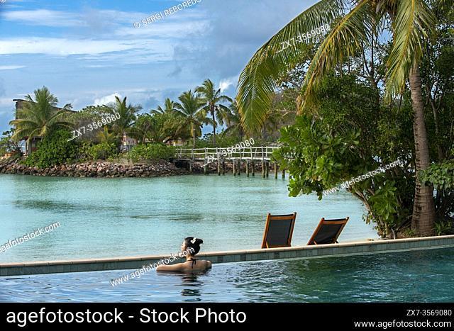 Nice asian woman in the infinity pool at Likuliku Resort, Malolo Island Mamanucas island group Fiji