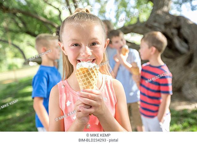 Caucasian girl eating ice cream cone