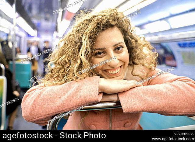 woman in public transport metro train, in Paris, France