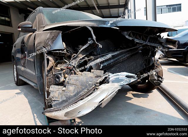 damaged front face of black car