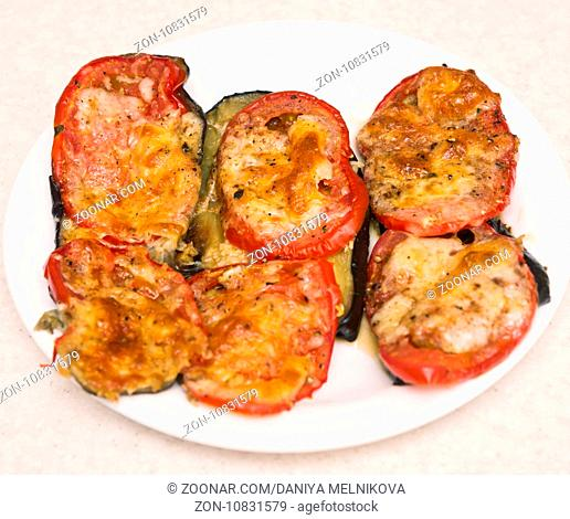 fried eggplants with tomato and cheese