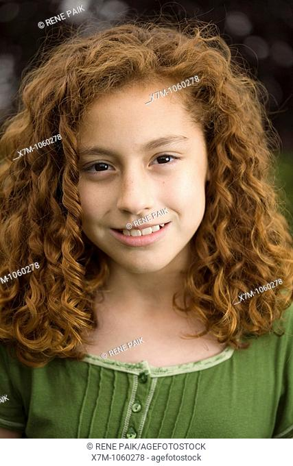 Smiling young red-headed girl  Mixed race, Mexican and caucasian
