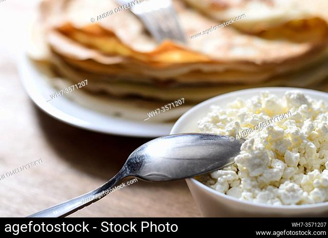 homemade pancakes on a white plate with cottage cheese