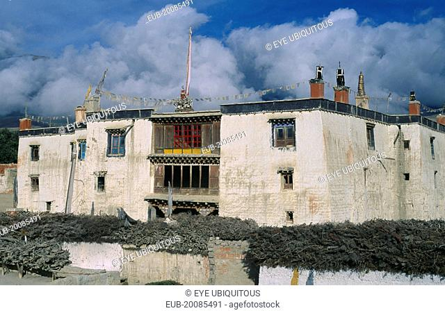 Present palace of King Jigme Palbar Bista. Exterior with flat roof, shrine and prayer flags