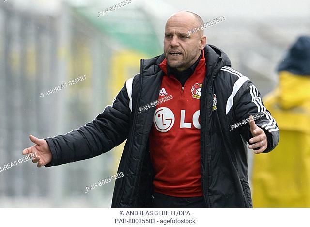 Leverkusen's coach Thomas Obliers gestures at the German women's Bundesliga soccer match between Bayern Munich and Bayer Leverkusen in Munich, Germany