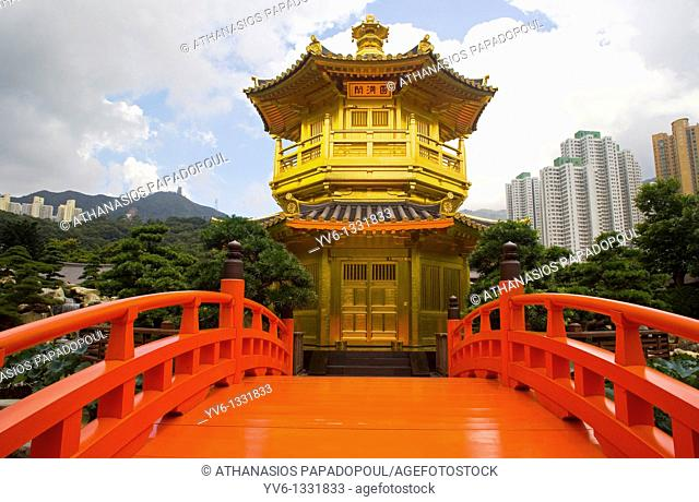CHINA HONG KONG KOWLOON WONG TAI SIN NAN LIAN GARDENS DIAMOND HILL Low angle view of a Tang Dynasty Style Chinese Golden Temple With Red Wooden Bridge Known As...