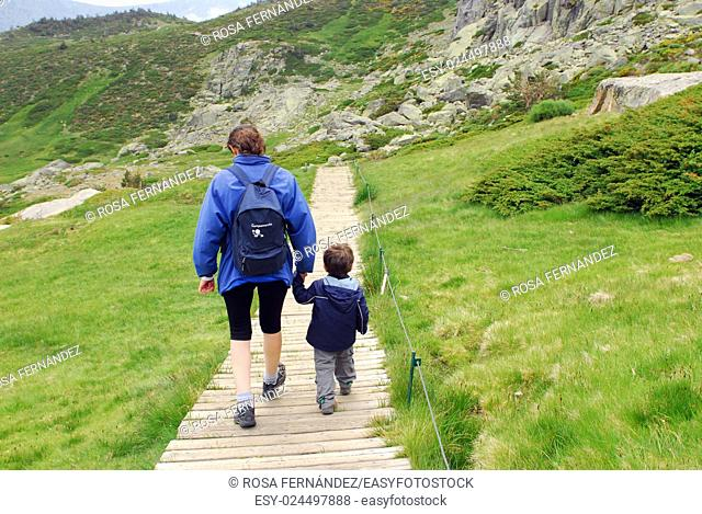 Mother and child walking by the country, Rascafría, Guadarrama National Park, Madrid, Spain