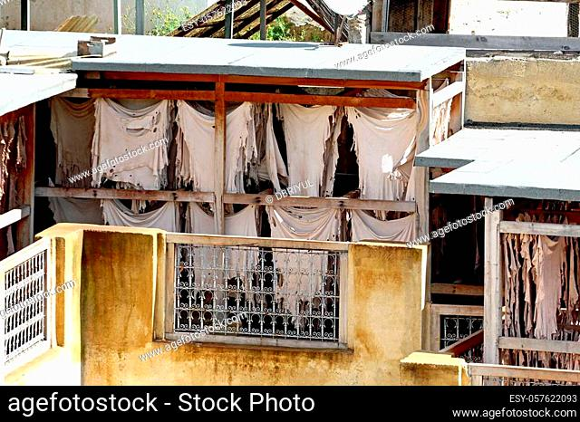 Rooftop tannery in Moroccan city of Fes with dying pits and drying racks