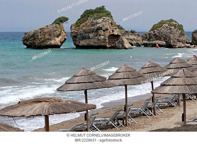 Sunshades and sun loungers on the beach of Porto Zoro, Zakynthos island, Greece, Europe