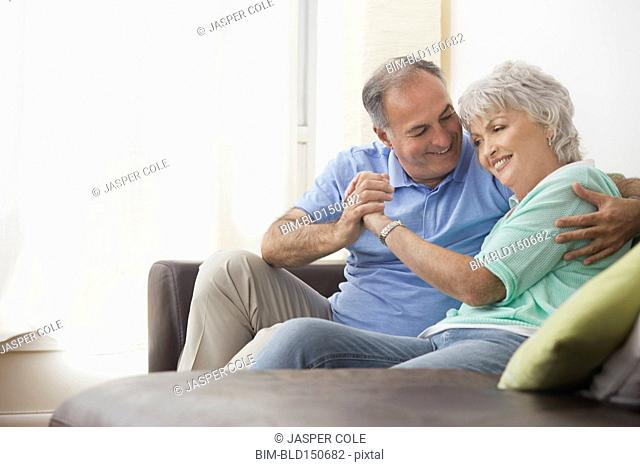 Older couple relaxing on sofa