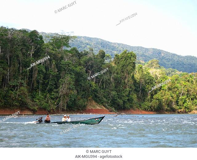 Local transport by longboat with powerful engine on the Alto Madre de Dios River in the Lower Amazon rainforest in Madre de Dios department in Peru