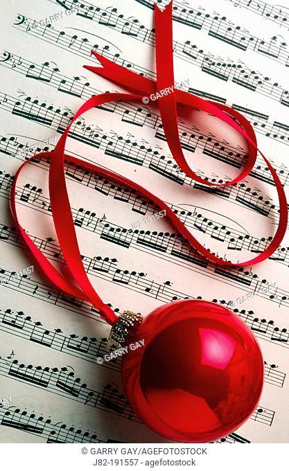 Christmas ornament on sheet music
