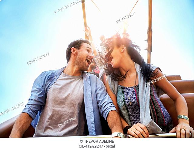 Exhilarated young couple on amusement park ride