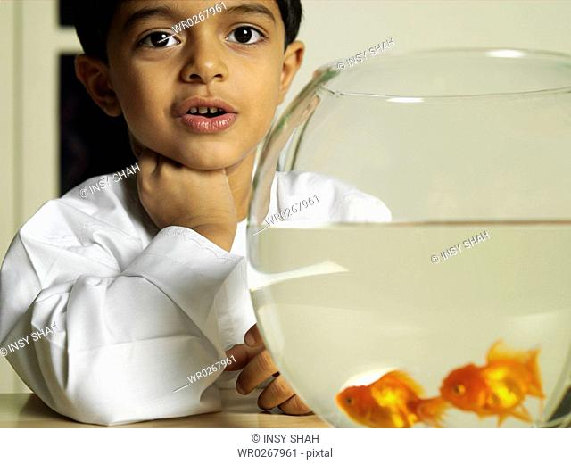 Aquarium infront of Arab Boy