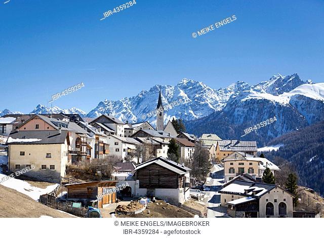 Mountain village Guarda in front of snowy mountains, Lower Engadine, Scuol-Guarda, Graubünden Canton, Switzerland