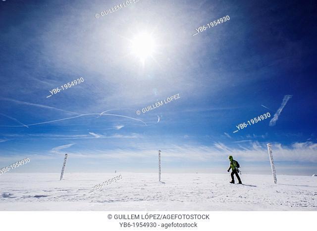 A female trekker walking in a winter landscape, Sklarska Poreba, Poland