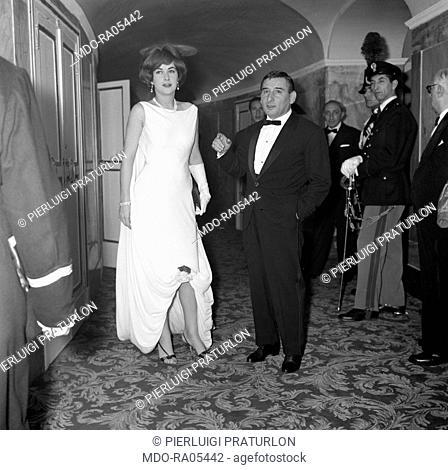 Italian actor Renato Rascel (Renato Ranucci) with his French wife Huguette Cartier attending to the premiere of The Tempest