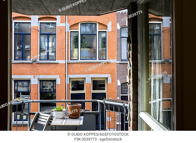 Tilburg, Netherlands. View from a first floor balcony towards opposite residential buildings and neighbours