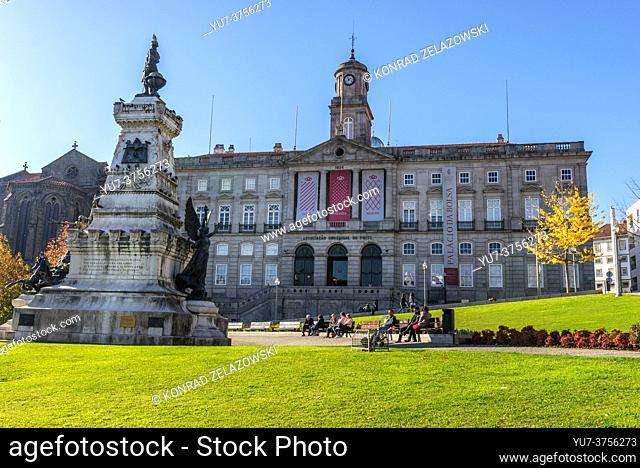 Infante D. Henrique (Prince Henry the Navigator) statue and Palacio da Bolsa (Stock Exchange Palace) in Porto city, Portugal