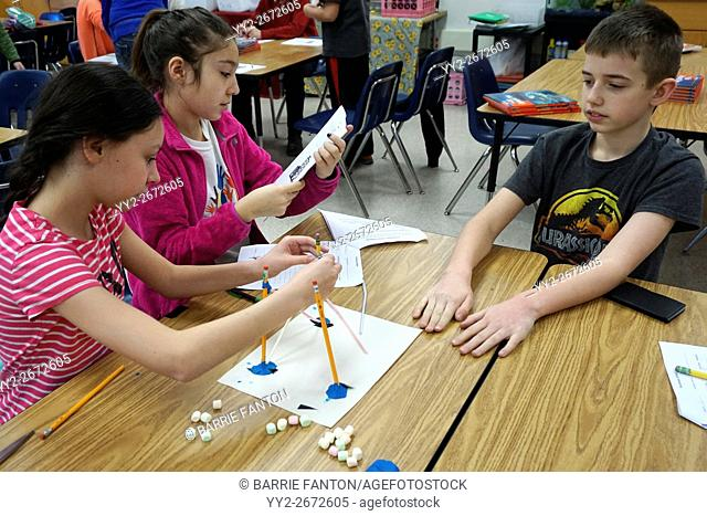 Middle Schoolers Working on Science Experiment, Wellsville, New York, USA
