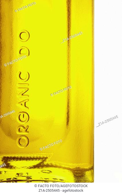Organic olive oil bottle with the denomination of origin sign on white background
