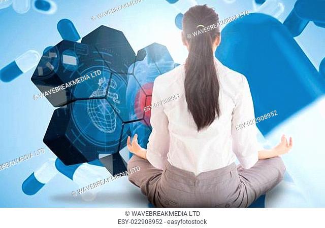 Composite image of businesswoman sitting in lotus pose