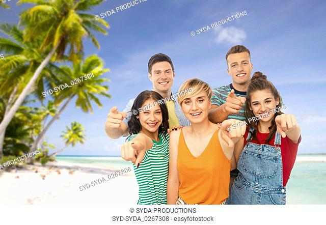 friends pointing at you over tropical beach