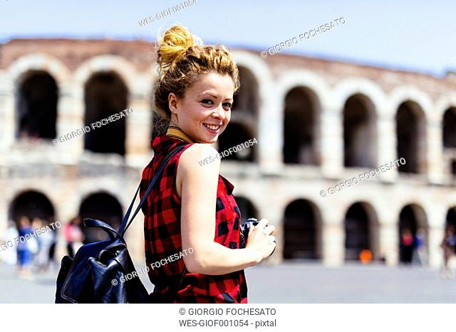 Italy, Verona, smiling woman in front of Verona Arena