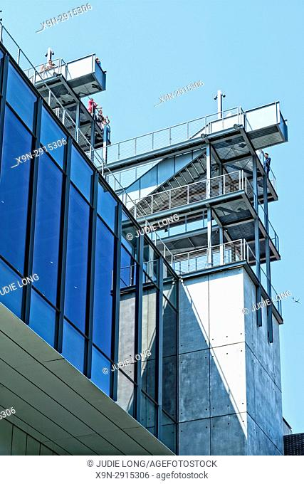 New York City, Manhattan, Meat Packing District. Close up of the Whitney Museum Building, Designed by Renzo Piano, Showing Upper Floors and Rooftop Outdoor...