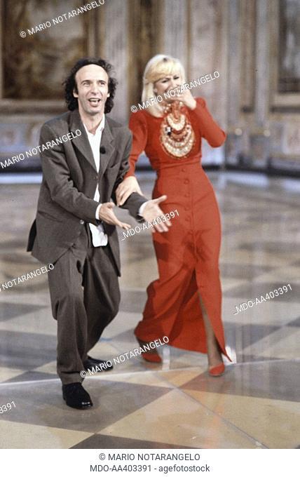 Roberto Benigni e Raffaella Carrà laughing in Fantastico 12. Italian actor and director Roberto Benigni and Italian showgirl Raffaella Carrà (Raffaella Maria...