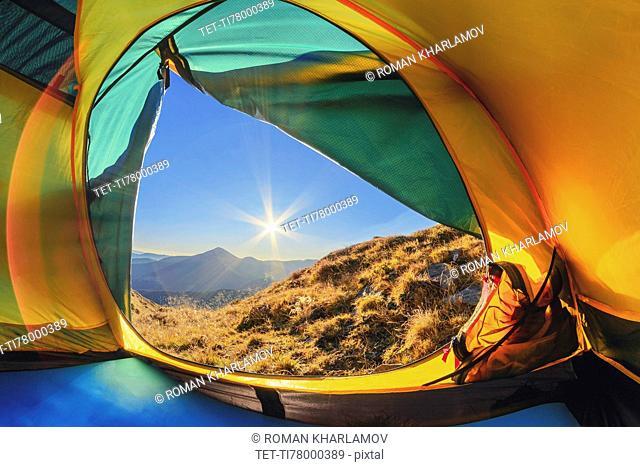 Ukraine, Zakarpattia region, Rakhiv district, Carpathians, Chornohora, View from tent on mountain Hoverla and mountain Petros