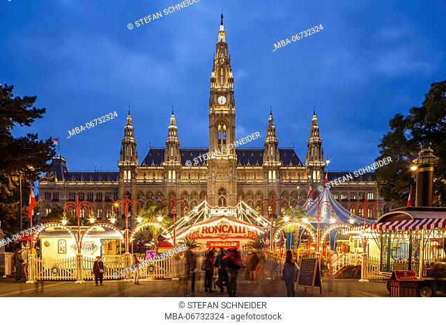 The city hall in Vienna during the blue hours, in the foreground the circus Roncalli on the Rathausplatz (square)