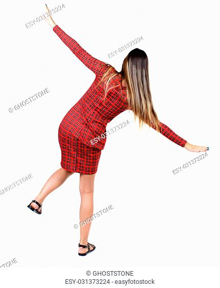 Balancing young woman. or dodge falling woman. Rear view people collection. backside view of person. Isolated over white background
