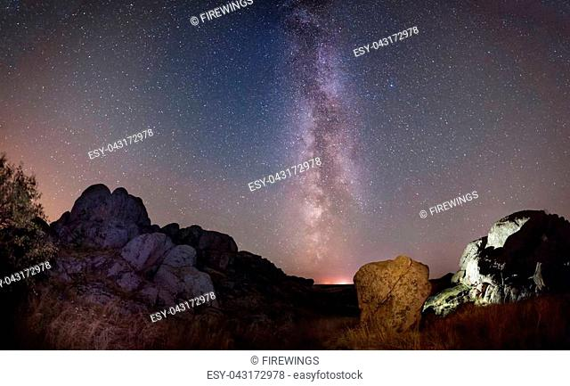 Night landscape in mountains, beautiful milky way in sky