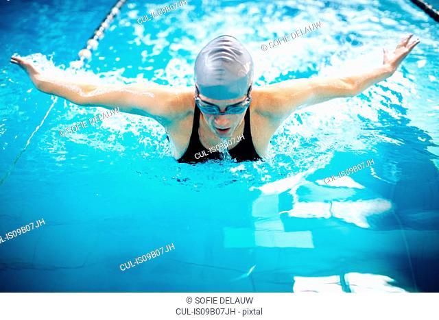 Woman swimming doing butterfly stroke