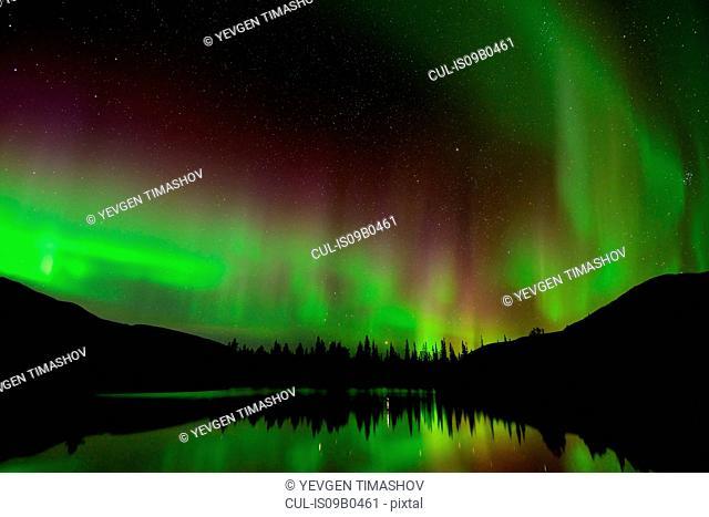 Green aurora borealis at Polygonal Lakes at night, Khibiny mountains, Kola Peninsula, Russia