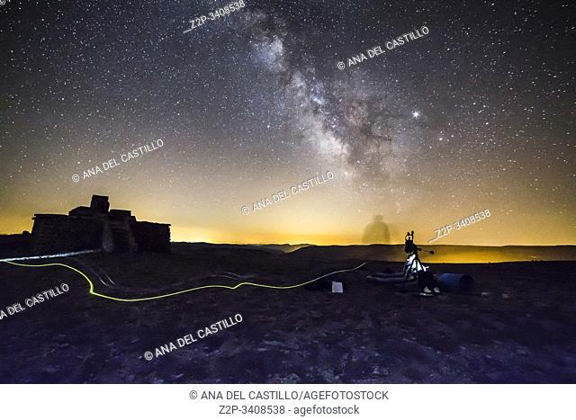 Milky way over night pollution and mountains in Valdelinares over 2000 meters high view point Teruel Aragon Spain Starlight spot. Hornillo viewpoint