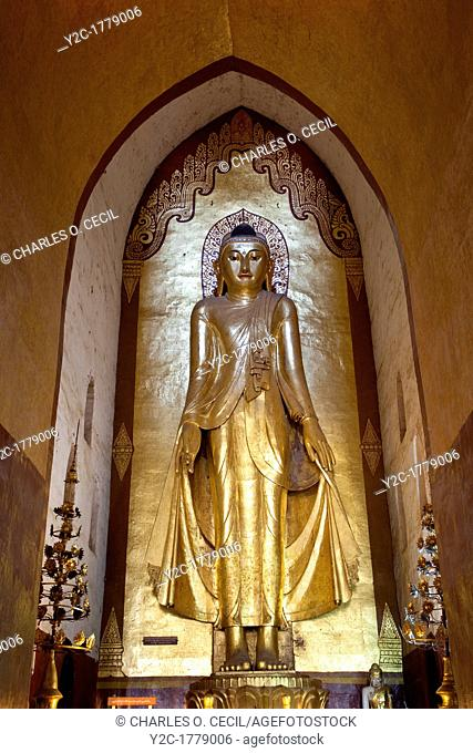 Myanmar, Burma  Bagan  Buddha Statue, Ananda Temple, teak covered with gold leaf  This is the Buddha on the east side of the temple