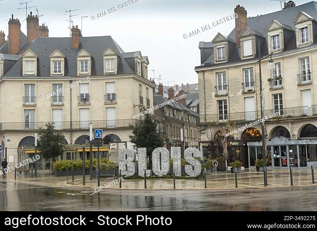 BLOIS FRANCE ON DECEMBER 31, 2019: Cityscape Blois in France with ancient stone bridge Jacques-Gabriel over the Loire River in a foggy morning