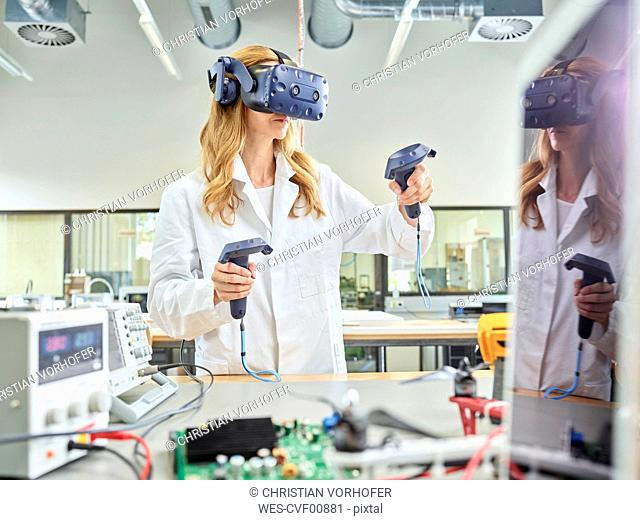 Female technician working with 3D glasses